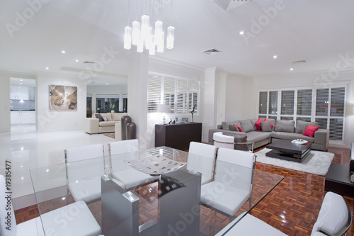 Luxurious dining room with living rooms and kitchen in the backg
