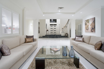 Luxurious living room with grand entrance in the background