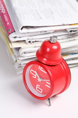 red clock and newspaper
