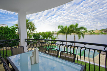Balcony entertainment area of waterfront house