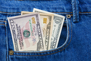 US currency dollar notes in pocket of jeans