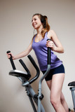 Girl on training apparatus  in sportclub poster