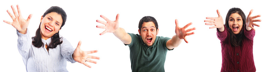 Three excited young people with hands extended isolated