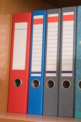 Multi-coloured folders.