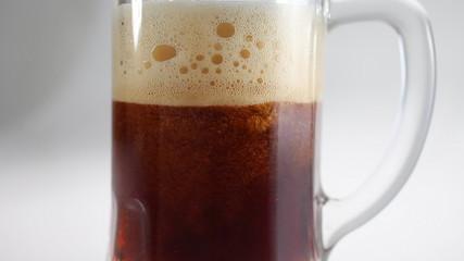 Beer pour in glass beer mug closeup
