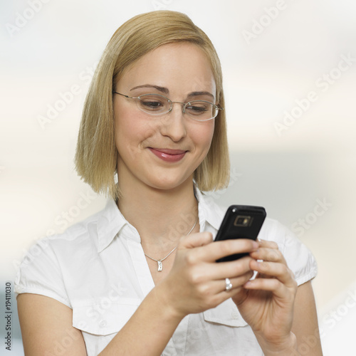 young woman looking on mobile phone