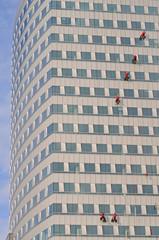 Men washing windows at a high altitude