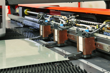 close up of cnc punching machine with metal sheet