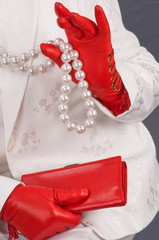 Hands female in red gloves.