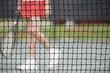 Senior woman at the tennis net