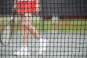 Senior woman at the tennis net