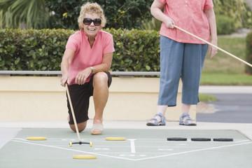 Senior women competing at sports