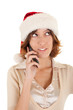 young girl in a Santa Claus hat and a mobile phone in hand