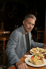 Mature man dining in a Mexican restaurant