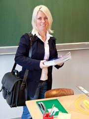 Teacher with blubooks