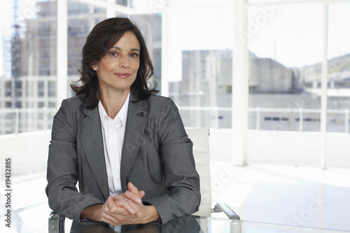 Businesswoman with contructions in the background