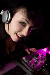Girl with headphones DJing