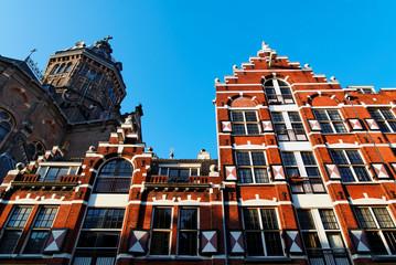Saint Nicholas Church and Red Facade Amsterdam