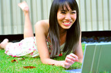 Pretty Asian Girl using her laptop in the park