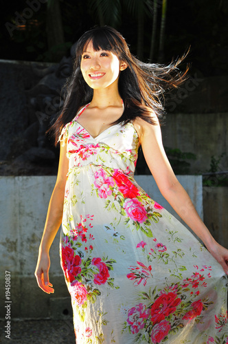 Pretty Asian Girl gliding past