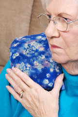 Senior Woman With Medical Herb Hot Pack