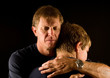 Leinwanddruck Bild - emotional embrace - father hugging son