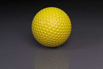 Yellow golfball on gray slightly reflective background