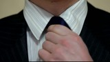 man tightens his tie
