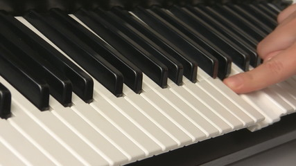 Hands trying piano keyboard