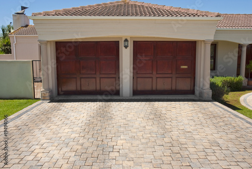 Wooden brown double garage doors