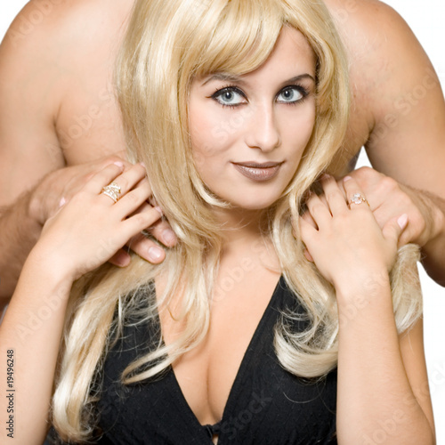 Blonde smile girl and mans hands