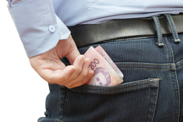 Man hiding money into his hip pocket