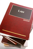 stack of law books from above,on white poster