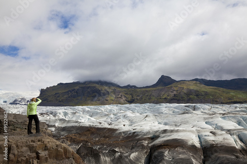 Woman Hiker Looking Across The Vatnajokull Glacier Iceland