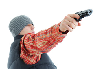 Young man is aiming with gun