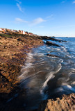 Incoming tide at the coast in Anstruther, Scotland poster