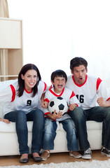Animated family watching a football match
