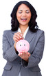 Positive businesswoman saving money in a piggybank