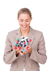 Confident businesswoman looking at a molecule