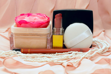 cosmetics on the background of pink fabric