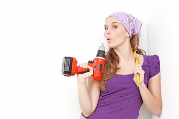 woman with drill doing home improvement