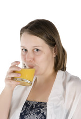 girl drinks orange juice.