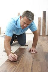 Builder Laying Wooden Flooring