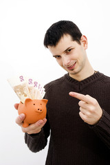 Young guy with piggy bank
