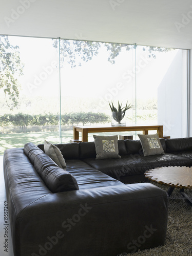 Modern living room and glass wall in modern home