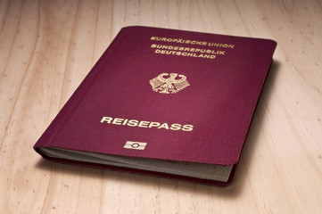 german passport on wooden board