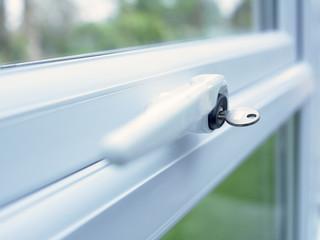 Close up of key in window lock