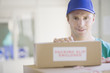Delivery man stacking cardboard boxes