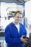 Mechanic in coveralls in auto repair shop