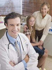 Doctor with patient and her mother in doctor?s office